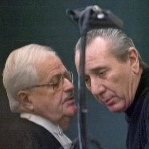 Vito Rizzuto (right) reputed head of the Montreal Mafia, speaks with his attorney Jean Salois after his hearing in Montreal Friday, Feb. 6, 2004. Rizzuto faces extradition to the United States to face charges related to the murders of three Mafia captains in New York in 1981. (CP PHOTO/Ryan Remiorz)