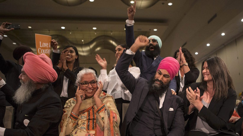 Jagmeet Singh, centre right, sits with his mother Harmeet Kaur, centre left, father Jagtaran Singh, left, and campaign manager Michal Hay, right, as it's announced he has won the first ballot in the NDP leadership race to be elected the leader of the federal New Democrats in Toronto on Sunday, October 1, 2017. THE CANADIAN PRESS/Chris Young