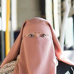 Warda Naili poses for a photograph on a city bus in Montreal, Saturday, October 21, 2017. Warda Naili says the first time she donned a niqab six years ago, it became a part of her. The Quebec woman, a convert to Islam, said she decided to cover her face out of a desire to practice her faith more authentically and to protect her modesty. THE CANADIAN PRESS/Graham Hughes