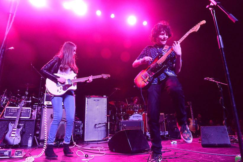 """Actor/musician Finn Wolfhard (right) performs onstage with his band Calpurnia during the """"Strange 80's"""" benefit at The Fonda Theatre on May 14, 2017 in Los Angeles, California. (Scott Dudelson/Getty Images)"""