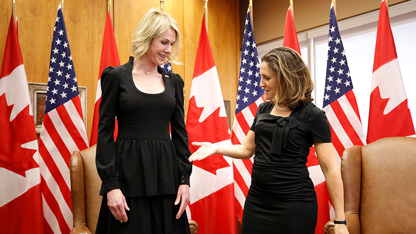 Canada's Foreign Minister Chrystia Freeland (R) reaches out to shake hands with new U.S. Ambassador to Canada Kelly Craft during a meeting at the Lester B. Pearson Building in Ottawa, Ontario, Canada October 23, 2017. (Chris Wattie/Reuters)