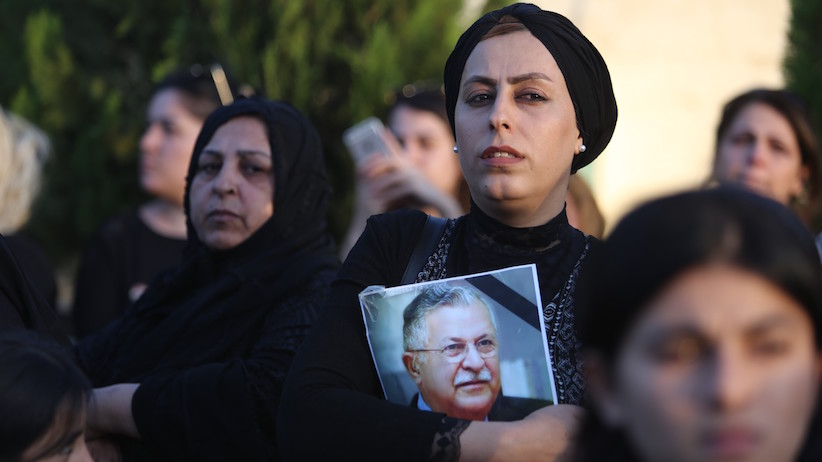 SULAYMANIYAH, IRAQ - OCTOBER 04: An Iraqi woman expresses her grief over Kurdish former President of Iraq, Jalal Talabani's death as she holds a portrait of Talabani in front of Kurdish Patriotic Union's building in Rizgari neighborhood of Sulaymaniyah, Iraq on October 04, 2017. Jalal Talabani, died in Germany at the age of 83. (Photo by Feriq Ferec/Anadolu Agency/Getty Images)