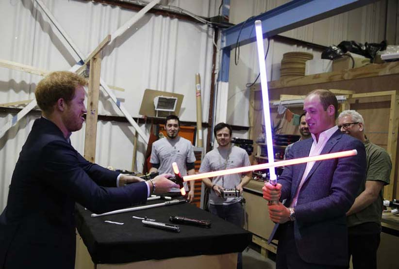 Prince Harry (L) and Prince William, Duke of Cambridge try out light sabres during a tour of the Star Wars sets at Pinewood studios on April 19, 2016 in Iver Heath, England. Prince William and Prince Harry are touring Pinewood studios to visit the production workshops and meet the creative teams working behind the scenes on the Star Wars films. (Adrian Dennis/WPA/Getty Images)
