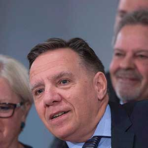 Coalition Avenir Quebec Leader Francois Legault, centre, is applauded at a news conference marking the end of the spring session, Friday, June 16, 2017 at the legislature in Quebec City. Legault is accompanied by members of his caucus. THE CANADIAN PRESS/Jacques Boissinot