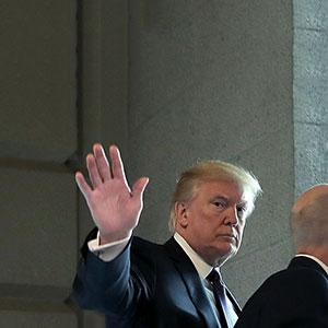 U.S. President Donald Trump (C) waves to journalists as he arrives at the U.S. Capitol for a meeting with the House Republican conference November 16, 2017 in Washington, DC. Trump is huddling with House GOP members on the day they hope to pass tax reform legislation, moving the president one step closer to a promised tax cut for corporations and some individual Americans before the end of the year.  (Chip Somodevilla/Getty Images)