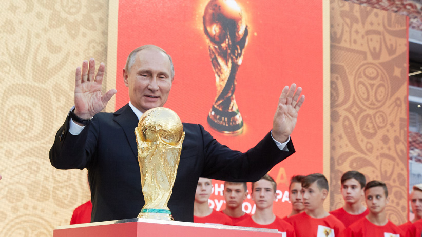 FIFA President GianniInfantino and President of Russian Federation Vladimir Putin stay on the stage with a Trophy during FIFA World Cup Trophy Tour at Luzhniki stadium on September 9, 2017 in Moscow, Russia. (Oleg Nikishin/FIFA/Getty Images)