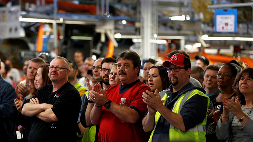 FCA assembly workers attend the celebration of the production launch of the all-new 2017 Chrysler Pacifica minivan at the FCA Windsor Assembly plant in Windsor, Ontario, May 6, 2016. REUTERS/Rebecca Cook - S1BETCNEVUAA