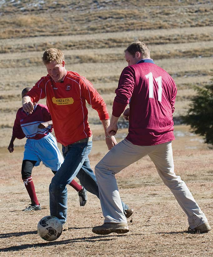 Prince William and Prince Harry play football with children during a visit to the Semongkong Children's Centre on June 17, 2010 in Semongkong, Lesotho. The Princes are on a joint trip to Southern Africa to visit projects supported by their respective charities Tusk Trust (Prince William) and Sentebale (Prince Harry). (Samir Hussein/wireimage/getty images)