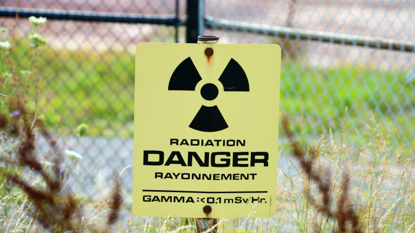 A radiation warning sign at the Port Granby Radioactive Waste management project in Clarington, Ont. on August 28, 2017. (Stephen C. Host/CP)