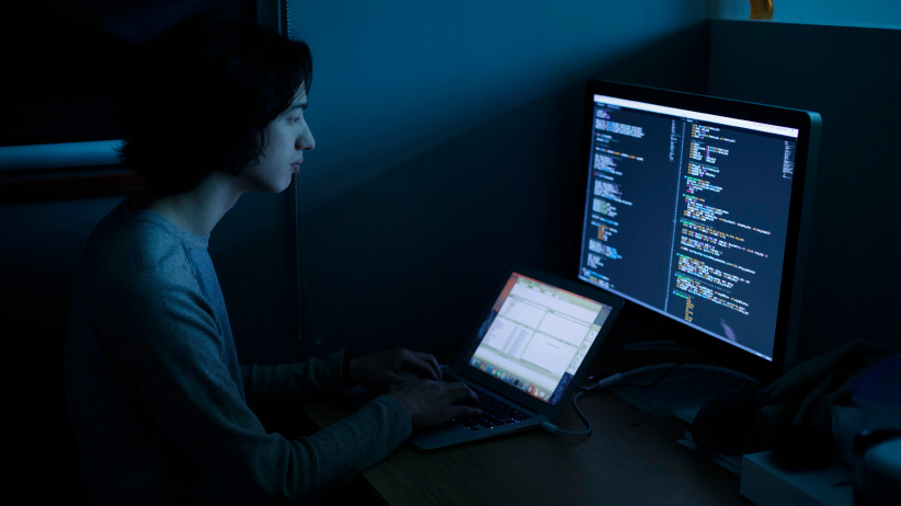 Computing Science Program student Niko Yasui, works on code at the University of Alberta in Edmonton Alberta. (Photograph by Jason Franson)