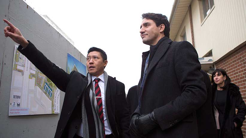 Prime Minister Justin Trudeau (right) stands with Jason Chen, Development Director at Toronto Community Housing as he visits a housing development in Toronto's Lawrence Heights neighbourhood ahead of a policy announcement, on Wednesday November 22, 2017. THE CANADIAN PRESS/Chris Young
