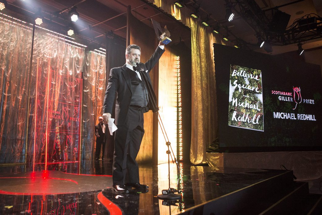 """Author Michael Redhill celebrates winning the 2017 Giller Prize for his novel """"Bellevue Square"""" in Toronto on Monday, November 20, 2017. THE CANADIAN PRESS/Chris Young"""