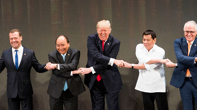 From left: Prayut Cha-O-Cha, prime minister of Thailand; Dmitry Medvedev, prime minister of Russia; Nguyen Xuan Phuc, prime minister of Vietnam; President Donald Trump; President Rodrigo Duterte of the Philippines; Malcolm Turnbull, prime minister of Australia; and Lee Hsien Loong, prime minister of Singapore, shake hands at the opening ceremony of the Association of Southeast Asian Nations summit in Manila, Philippines, Nov. 13, 2017. (Doug Mills/The New York Times)