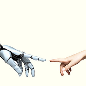 Cybernetic robot hand and child's hand point toward each other. (Coneyl Jay/Getty Images)