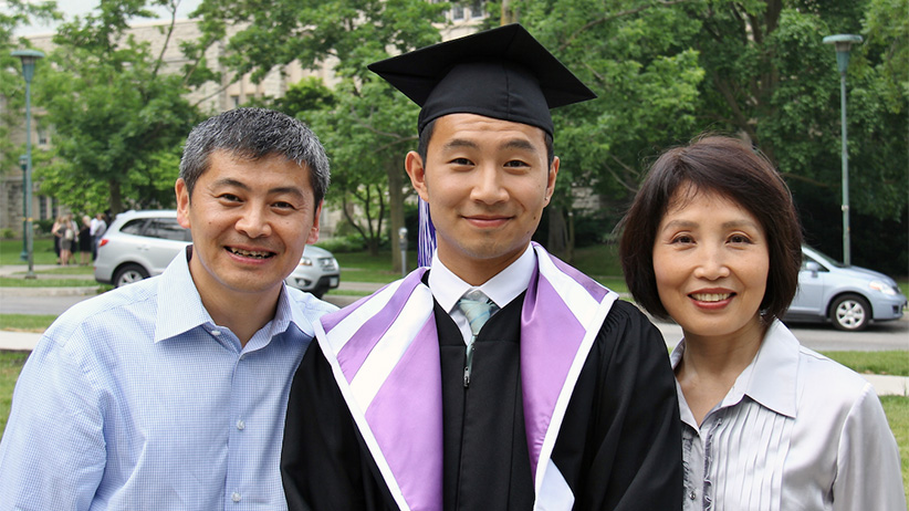 Liu, flanked by his parents, at his graduation from Western University.