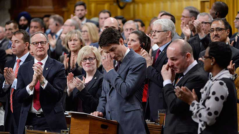 Prime Minister Justin Trudeau wipes his eye while he is applauded while making a formal apology to individuals harmed by federal legislation, policies, and practices that led to the oppression of and discrimination against LGBTQ2 people in Canada, in the House of Commons in Ottawa, Tuesday, Nov.28, 2017. THE CANADIAN PRESS/Adrian Wyld