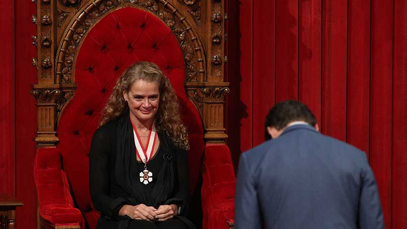 Canadian Prime Minister Justin Trudeau bowes to the new the Governor general Julie Payette at the senate in Ottawa, Ontario, October 2, 2017.  The former astronaut Julie Payette is the 29th Governor General of Canada.  / AFP PHOTO / Lars Hagberg        (Photo credit should read LARS HAGBERG/AFP/Getty Images)
