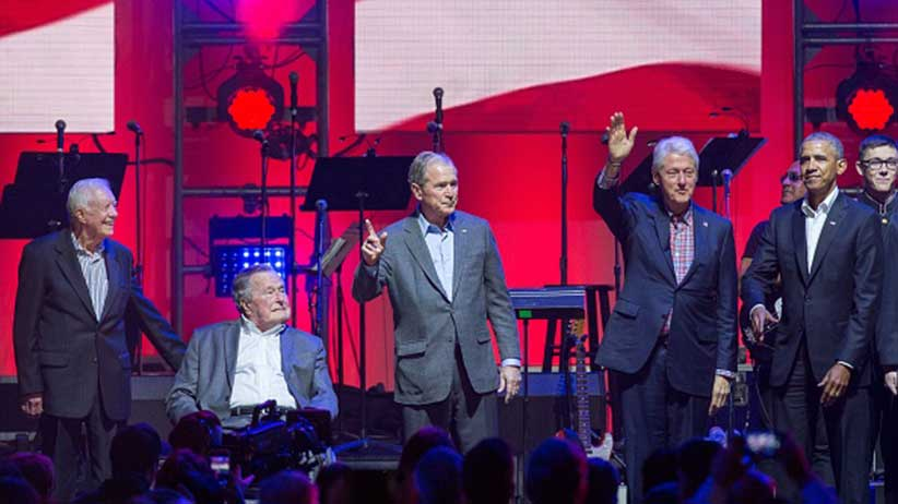 (L-R) Former US Presidents, Jimmy Carter, George H. W. Bush, George W. Bush, Bill Clinton and Barack Obama attend the Hurricane Relief concert in College Station, Texas, on October 21, 2017. / AFP PHOTO / JIM CHAPIN (Photo credit should read JIM CHAPIN/AFP/Getty Images)