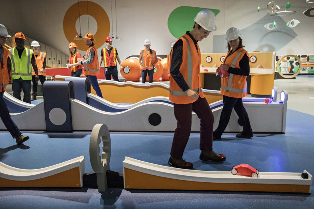 Museum tour guides build and race cars in the ZOOOM - Children's Innovation Zone at the newly renovated Museum of Science and Technology in Ottawa October 25, 2017. Photograph by Blair Gable An 8,000 sq. ft. space for children two to eight years of age, this gallery is composed of nine circle-themed modules providing opportunities for play and experimentation. At its heart is the spirit of innovation that drives discovery. The gallery will feature elements of surprise and experimentation including a designated toddler area in close proximity to a family room, an interactive gear wall, a building station with over-sized foam blocks, a multi-sensorial play structure where children can run, a vehicle building station and test ramp, a light and sound console, and wind vortex with a large circular path and animated features.