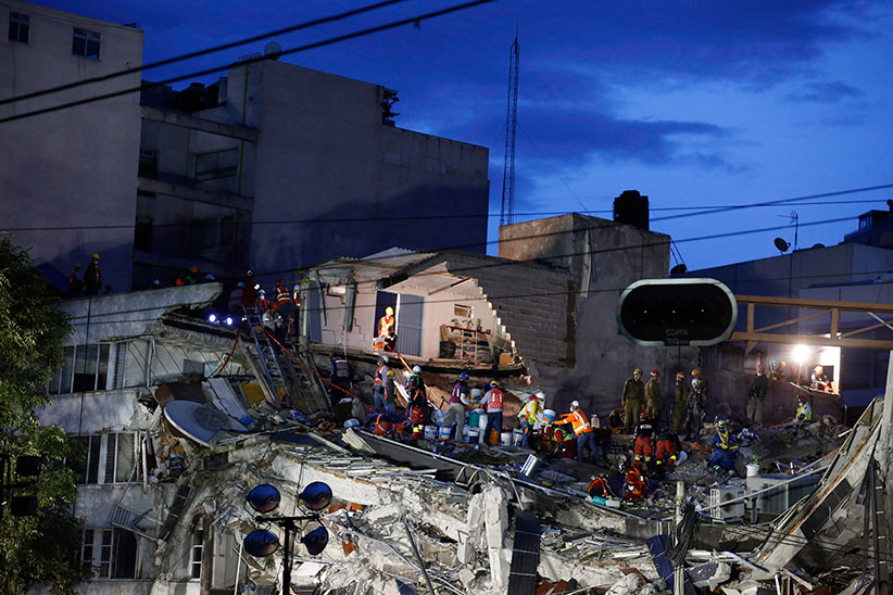 Rescuers race to save people believed to be still alive inside a collapsed office building in the Roma Norte neighborhood of Mexico City, as night falls Friday, Sept. 22, 2017, three days after a 7.1 magnitude earthquake. Hope mixed with fear Friday in Mexico City, where families huddled under tarps and donated blankets, awaiting word of their loved ones trapped in rubble. (Rebecca Blackwell/AP)