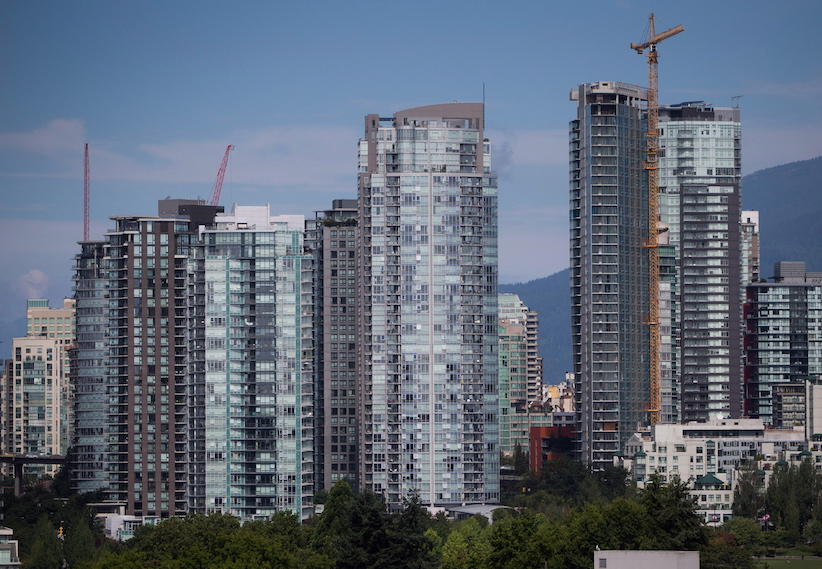 Condo Towers, Including One Under Construction, Right, Are Seen In Downtown  Vancouver, B.C., On August 15, 2017. (Darryl Dyck/CP)