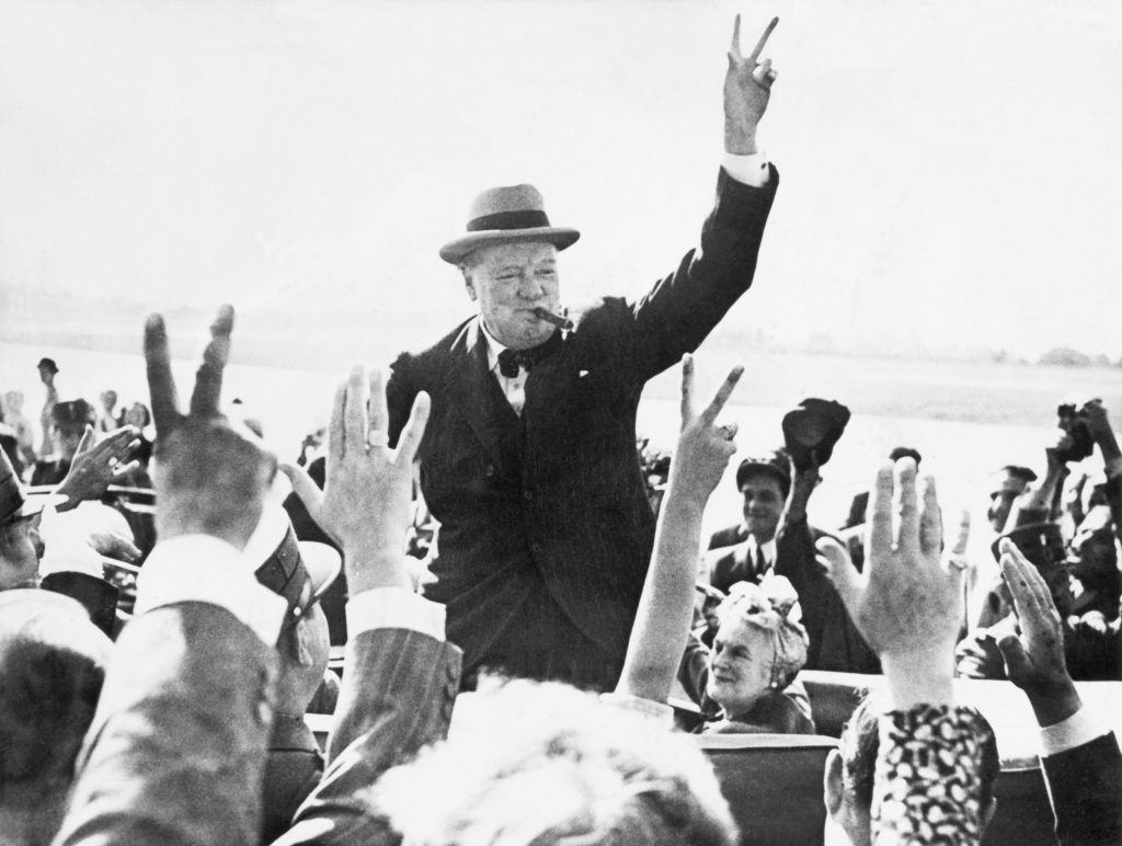 Sir Winston Churchill Makes The Victory Sign As He Greets