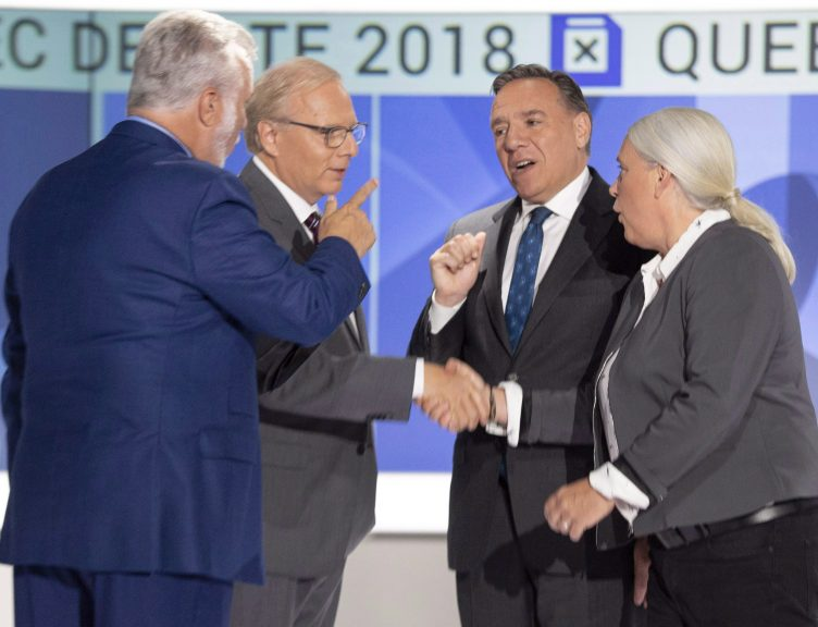 Quebec Liberal leader Philippe Couillard, left to right, PQ leader Jean-Francois Lisee, CAQ leader Francois Legault and Quebec Solidaire leader Manon Masse shake hands before their English debate September 17, 2018 in Montreal, Que. (Ryan Remiorz/CP)