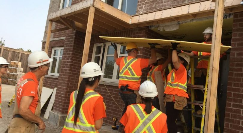 Home Depot employees working on a Habitat for Humanity construction project in September 2017. (Habitat GTA)
