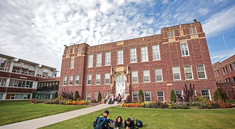 Concordia Edmonton students studying on a patch of grass