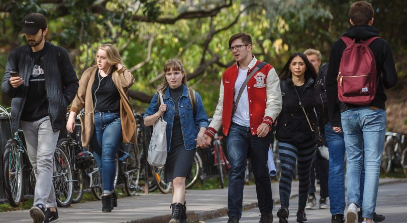 McGill students walking hand in hand on campus