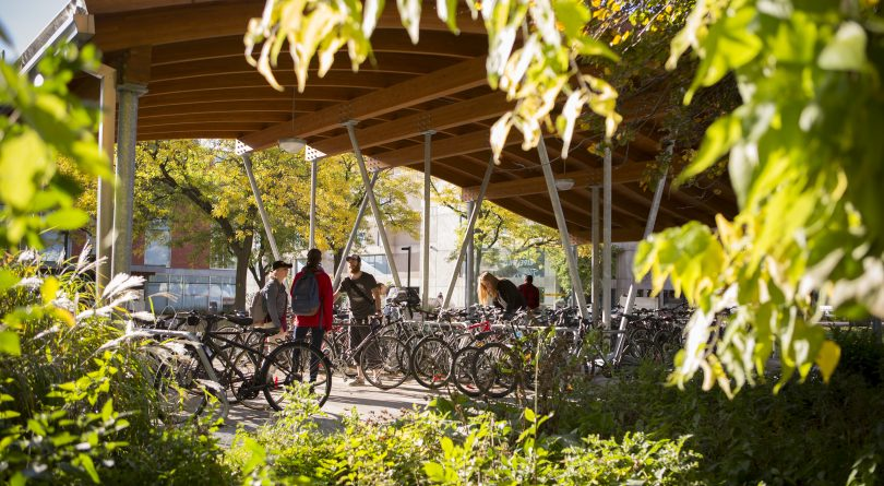 Guelph students locking up their bikes on campus