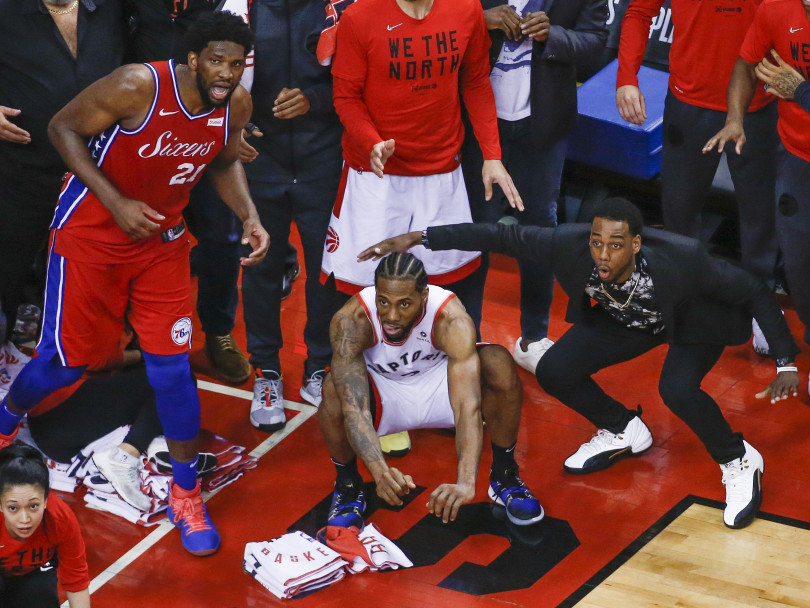 info for fd9fd 77faf Leonard, centre, squats  Philadelphia s Joel Embiid watches from the  corner  and Raptor s guard Jordan Lloyd, in street clothes, waits for the   The Shot  to ...