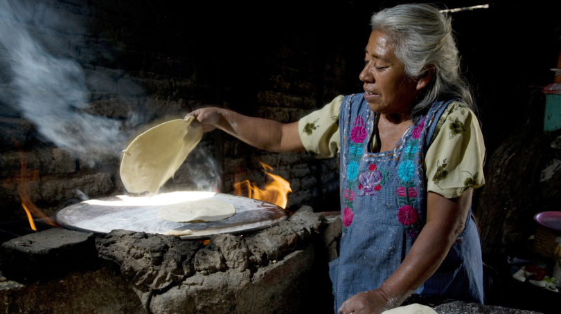Homemade tortillas made on the comal (griddle) heated by wood. Central Valleys of Oaxaca, Mexico. (Jean-Claude Teyssier)