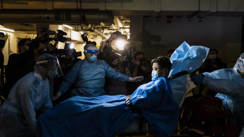 Paramedics transport a man believed to be Hong Kong's first COVID-19 case, in January (Lam Yik Fei/The New York Times/Redux Pictures)