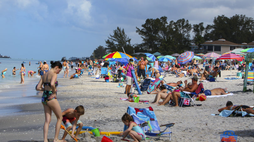 Englewood Beach in Charlotte County, Fla., was crowded on March 20, 2020. It was closed to the public starting at 6 am the following day (Thomas O'Neill/NurPhoto via Getty Images)