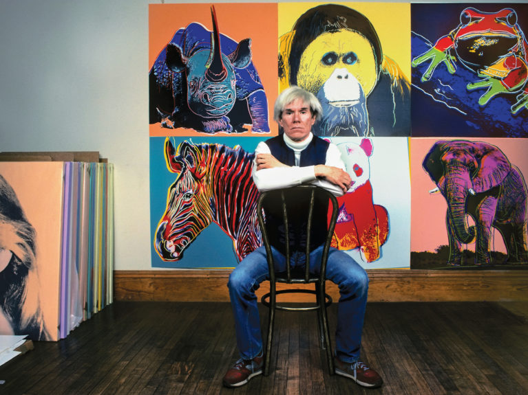 Warhol in 1983 at his studio, the Factory, with paintings from his Endangered Species series (Brownie Harris/Corbis/Getty Images)