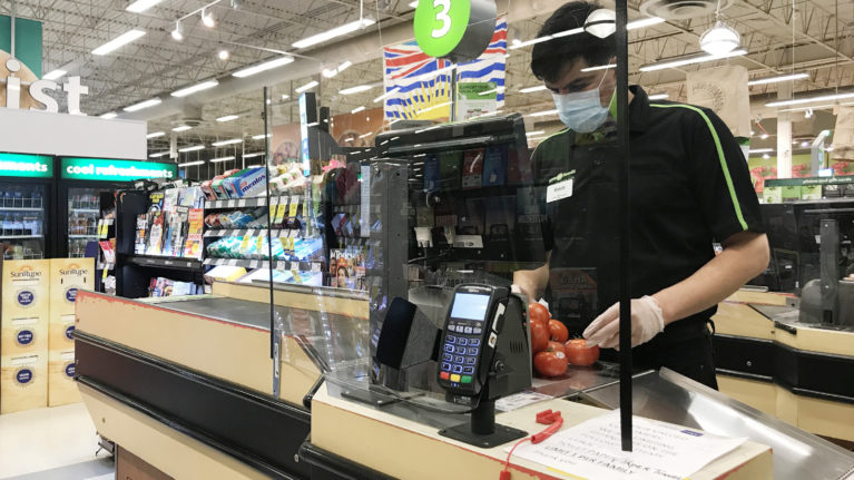 A plexiglass barrier is pictured creating a barrier to protect a cashier at a grocery store in North Vancouver, B.C. Sunday, March 22, 2020. (Jonathan Hayward/CP)