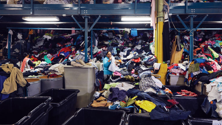Toronto Textile Recycling buys donated clothing, and employees sort and grade each piece before the clothes are sold around the world (Photograph by Christie Vuong)