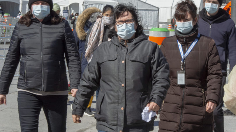 People wear masks as they leave the COVID-19 testing facility Friday, March 27, 2020 in Montreal.THE CANADIAN PRESS/Ryan Remiorz