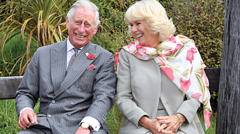 Prince Charles, Prince of Wales and Camilla, Duchess of Cornwall continue to laugh after a bubble bee took a liking to Prince Charles during their visit to the Orokonui Ecosanctuary on November 5, 2015 in Dunedin, New Zealand. (Rob Jefferies/Getty Images)