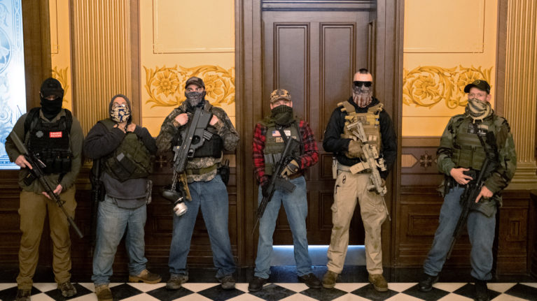 An armed group entered the Michigan State Capitol building to protest the stay-at-home orders, on April 30, 2020 (Seth Herald/Reuters)