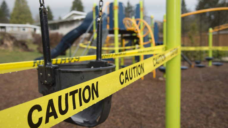Caution tape is pictured surrounding a children's play structure in North Vancouver, B.C. Monday, March 23, 2020. THE CANADIAN PRESS/Jonathan Hayward