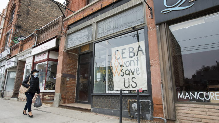 A closed store front boutique business called Francis Watson pleads for help displaying a sign in Toronto on Apr. 16, 2020. (Nathan Denette/CP)