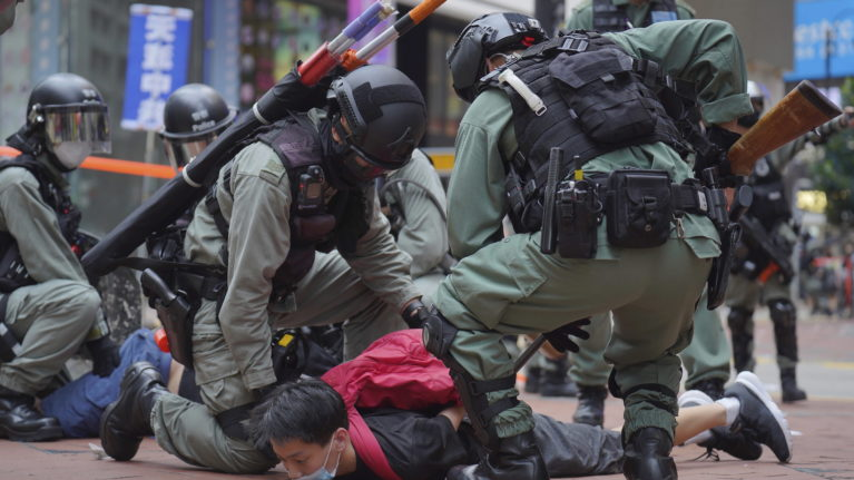 Riot police in Hong Kong detain a protester on Sunday during a demonstration against Beijing's national security legislation (Vincent Yu/AP)
