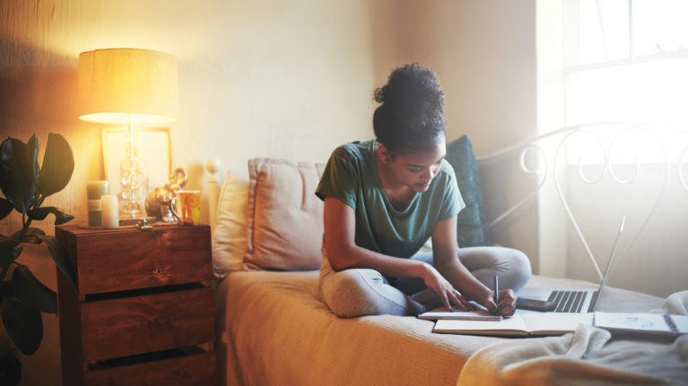 A diligent students works at home. (iStock)