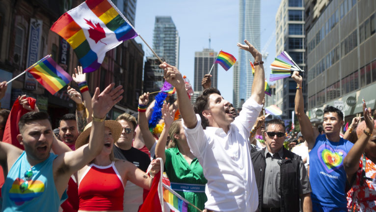 Prime Minister Justin Trudeau walks in Toronto's Pride parade on Jun. 23, 2019. (Chris Young/CP)
