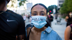 Protests across the U.S. began in May and continued into June: a protester in Los Angeles on May 27 (Jason Armond /Los Angeles Times/Getty Images)