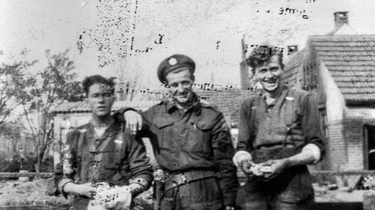 Photograph of three soldiers from Queen's Own Rifles during World War II in Amersfoort, Netherlands. (Courtesy of Irene Martin)