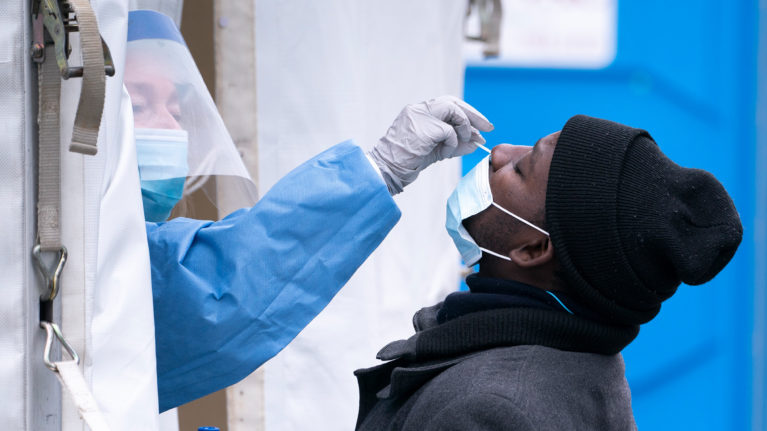 A man is tested at a temporary COVID-19 test clinic in Montreal, on Friday, May 15, 2020. (Paul Chiasson/CP)