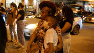 A woman embraces her son during a protest against the death in Minneapolis police custody of George Floyd, in St Louis, Missouri (Lawrence Bryant/Reuters)